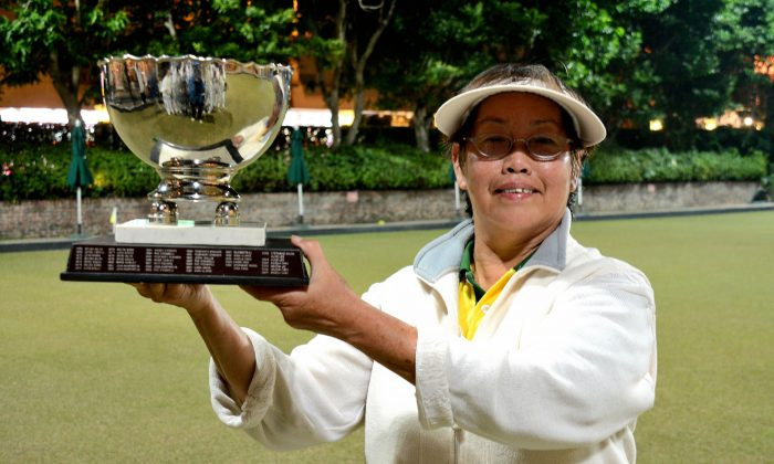 Hong Kong International Angela Chau proudly display her fifth National Knock-out Singles trophy after defeating Sanlia Wong from the Filipino Club in the final last Sunday, Jan 6, 2015. (Stephanie Worth)