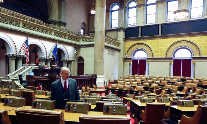 Assemblyman Dean Murray R-East Patchogue, in the Assembly Chamber at the state Capitol in Albany, N.Y., on Tuesday, Jan. 6, 2015. Murray won back his old Assembly seat and expected to be sworn in on Wednesday, Jan. 7, 2015. (AP Photo/Mike Groll)