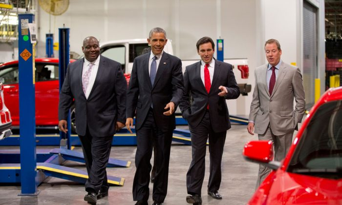 (L-R) Ford plans manager, Phillip Calhoun, President Barack Obama, Ford President and CEO Mark Fields and Bill Ford eye a new Mustang at Ford Michigan Assembly Plant, Wednesday, Jan. 7, 2015, in Wayne, Mich., where the president spoke about the resurgent American automotive and manufacturing sector. (AP Photo/Carolyn Kaster)