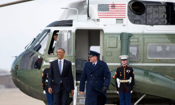 President Barack Obama walks from Marine One to board Air Force One, Wednesday, Jan. 7, 2015, at Andrews Air Force Base, Md., en route to Ford Michigan Assembly Plant in Wayne, Mich., to highlight the workers in the resurgent American automotive and manufacturing sector. (AP Photo/Carolyn Kaster)