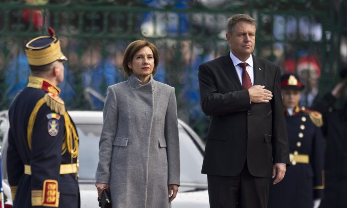 Romanian President Klaus Iohannis (R) and his wife Carmen review an honor guard during his inauguration ceremony in Bucharest on Dec. 21, 2014. (Daniel Mihailescu/AFP/Getty Images)