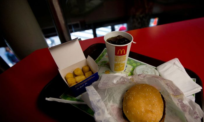 A Quarter Pounder meal is served with arepas or corn cakes at a local McDonald's, in Caracas, Venezuela, Tuesday, Jan. 6, 2015. McDonald's franchises in Venezuela have run out of potatoes and are now serving South American alternatives like deep-fried arepas or yuca, a starchy tuberous root. The franchisers are blaming a contract dispute with West Coast dock workers for halting the export of frozen fries to the country. (AP Photo/Fernando Llano)