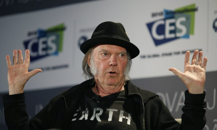 Musician Neil Young speaks during a session at the International CES Wednesday, Jan. 7, 2015, in Las Vegas. Pedram Abrari, Pono Music's vice president, credits Young's involvement with the company's online Kickstarter campaign in raising more than $6 million when it originally sought just $800,000.  (AP Photo/John Locher)