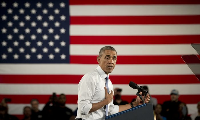 President Barack Obama speaks at Ford Michigan Assembly Plant, Wednesday, Jan. 7, 2015, in Wayne, Mich., about the resurgent American automotive and manufacturing sector. (AP Photo/Carolyn Kaster)