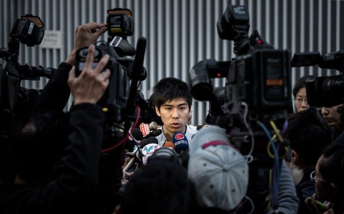Lester Shum, one of the leaders of the Federation of Students, talks to the media outside the government building in Hong Kong on Jan. 6, 2015. (Philippe Lopez/AFP/Getty Images)