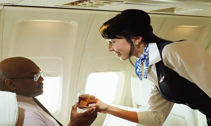 Don't get too cozy in your upgraded seat until you are up in the air. (Digital Vision/Thinkstock)