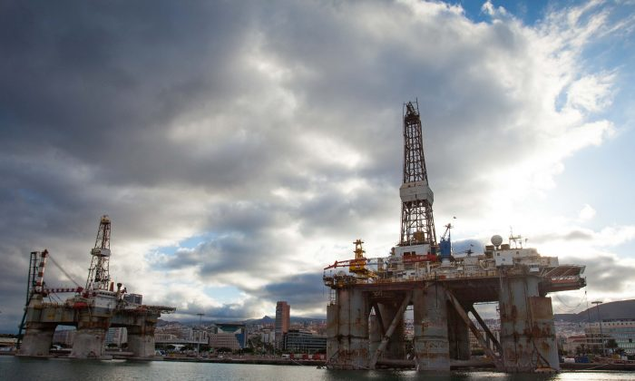 Oil Platforms undergoing maintenance are docked in the port of Santa Cruz de Tenerife on June 6, 2014. (Desiree Martin/AFP/Getty Images)