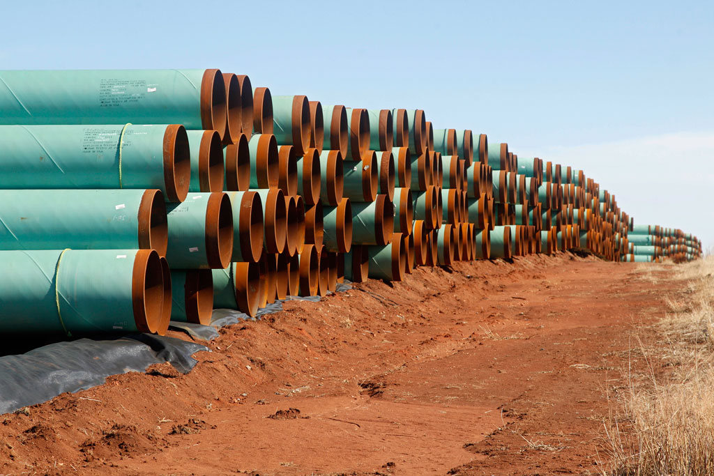 Miles of pipe ready to become part of the Keystone Pipeline are stacked in a field near Ripley, Okla., on Feb. 1, 2012. A bill to approve the Keystone XL oil pipeline cleared a key Senate committee Thursday, setting up a fight next week pitting newly empowered Republicans against President Barack Obama and Senate Democrats. The Senate Energy and Natural Resources committee moved the bill closer to the floor by a 13-9 vote. Sen Joe Manchin of West Virginia, one of six Democrats sponsoring the bill, was the only Democrat to support it in committee. The House will vote on its version of the bill Friday, and is expected to pass it easily. (AP Photo/Sue Ogrocki)