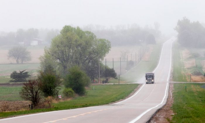 A truck traveling along highway 14, several miles north of Neligh, Neb., near the proposed new route for the Keystone XL pipeline, on April 19, 2012. A bill to approve the Keystone XL oil pipeline cleared a key Senate committee Thursday, setting up a fight next week pitting newly empowered Republicans against President Barack Obama and Senate Democrats. The Senate Energy and Natural Resources committee moved the bill closer to the floor by a 13-9 vote. Sen Joe Manchin of West Virginia, one of six Democrats sponsoring the bill, was the only Democrat to support it in committee. The House will vote on its version of the bill Friday, and is expected to pass it easily. (AP Photo/Nati Harnik)