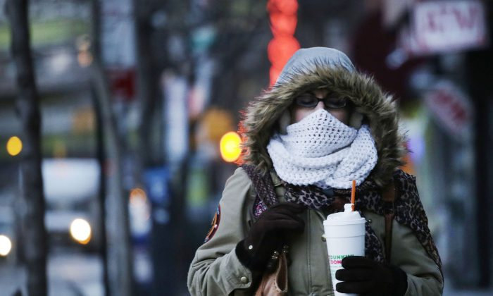 A woman carries a beverage in a plastic foam cup in New York City on Thursday, Jan. 8, 2015. Foam cups, plates, trays, and packaging peanuts will be banned in New York City beginning in July. (AP Photo/Mark Lennihan)