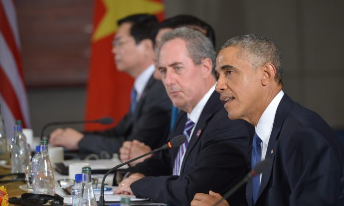 President Barack Obama (R) speaks during a meeting with leaders from the Trans-Pacific Partnership at the U.S. Embassy in Beijing on Nov. 10, 2014. At left is U.S. Trade Representative Mike Froman. (Mandel Ngan/AFP/Getty Images)