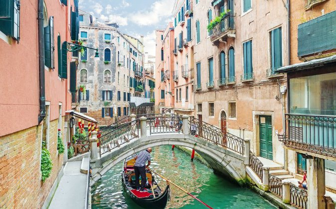 Canal in Venice, Italy via Shutterstock*