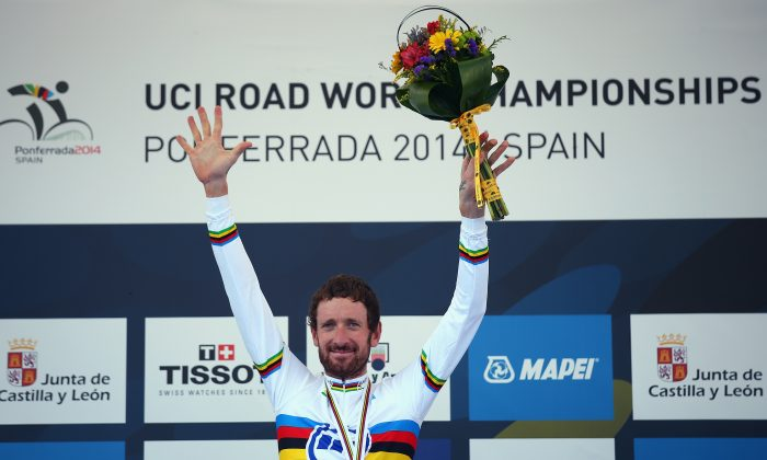 Sir Bradley Wiggins celebrates on the podium after winning the Elite Men's Individual Time Trial on day four of the UCI Road World Championships on September 24, 2014 in Ponferrada, Spain. (Bryn Lennon/Getty Images)
