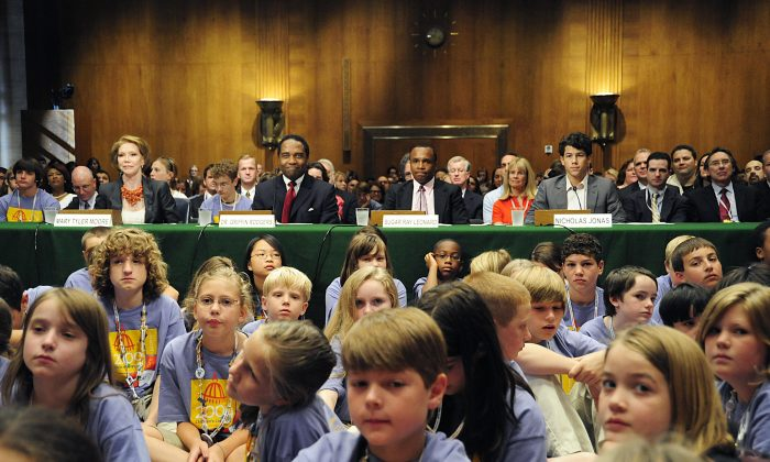 Celebrities and medical leaders sit surrounded by children living with Type 1 diabetes, waiting for a government hearing on Capitol Hill in June 2009. New research shows that for children with Type 1 diabetes, too much blood sugar can lead to slower growth in some areas of the brain. (Karen Bleier/AFP/Getty Images)