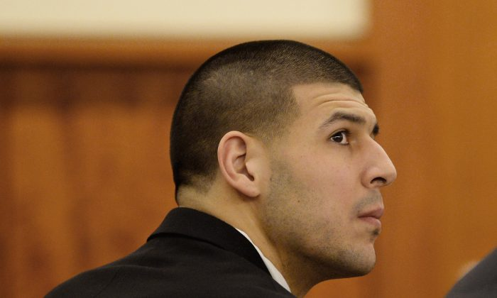 Former New England Patriots football player Aaron Hernandez attends a pretrial hearing in the first of two murder cases against him  at Bristol County Superior Court in Fall River, Mass., on Tuesday, Jan. 6, 2015. Hernandez is charged with murder in the killing of semi-pro football player Odin Lloyd in 2013. He also is charged with killing two men in Boston in 2012. Hernandez has pleaded not guilty in both cases.  (AP Photo/CJ Gunther, Pool)