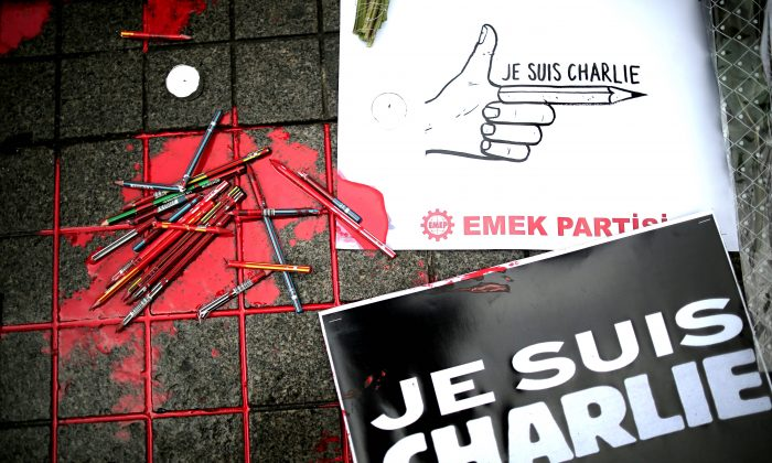 "Broken pens and placards that read: ""I am Charlie"" lay on the ground as members of a leftist party gather outside the French consulate to pay tribute to the victims of the French satirical newspaper Charlie Hebdo, in Istanbul, Turkey, Friday, Jan. 9, 2015. 12 people were killed on Jan. 7 in a terrorist attack at the Charlie Hebdo headquarters in Paris. (AP Photo/Emrah Gurel)"