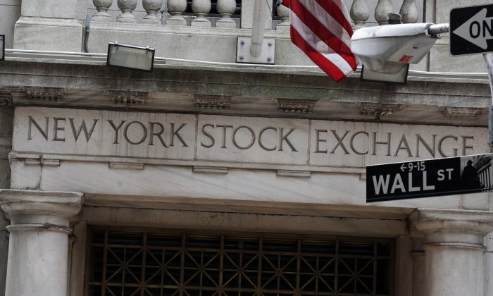 The Wall Street entrance of the New York Stock Exchange on Oct. 2, 2014. US stocks edged lower in early trading, Friday, Jan. 9, 2015, after two days of big gains. The government reported another strong round of hiring in December that helped push the unemployment rate down to a six-year low.  (AP Photo/Richard Drew)