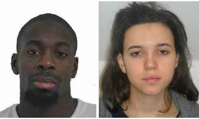 In this combination photo provided by the Paris Police Prefecture, Amedy Coulibaly (L), and Hayet Boumddiene, two suspects named by police as accomplices in a kosher market attack on the eastern edges of Paris on Friday, Jan. 9, 2015. A police official says the man who has taken at least five people hostage in a kosher market on the eastern edges of Paris Friday appears linked to the newsroom massacre earlier this week that left 12 people dead. Paris police released a photo of Amedy Coulibaly as a suspect in the killing Thursday of a policewoman, and the official named him as the man holed up in the market. He said the man is armed with an automatic rifle and some hostages have been gravely wounded. He said a second suspect, a woman named Hayet Boumddiene, is the gunman's accomplice. (AP Photo/Prefecture de Police de Paris)