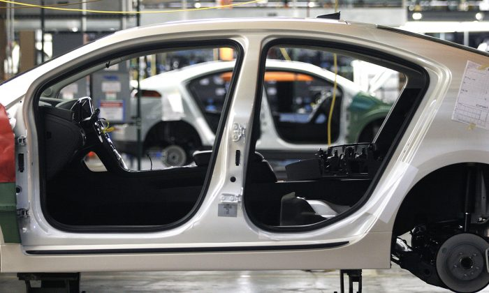 A current-generation Chevy Volt electric vehicle go through assembly at the General Motors Detroit Hamtramck Assembly Plant  in Hamtramck, Michigan. The company is set to reveal two new electric vehicles on Jan. 12, including a redesigned Volt. (Photo by Bill Pugliano/Getty Images)