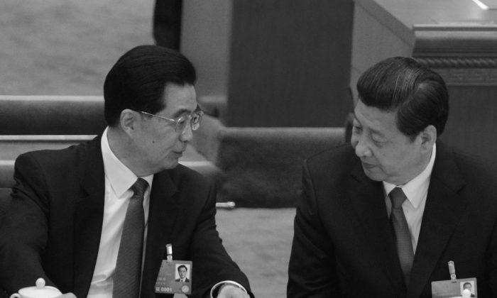 Former Chinese Communist Party leader Hu Jintao talks to newly-elected Party chief Xi Jinping at the closing session of the National People's Congress (NPC) in Beijing on March 17, 2013. Hu is said to have complained about the former communist leader Jiang Zemin. (Goh Chai Hin/AFP/Getty Images)