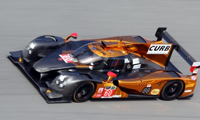 The #60 MSR Ligier-Honda roars around the banking at Daytona International Speedway during the Saturday afternoon session of the Roar Before the 24. (Chris Jasurek/Epoch Times)