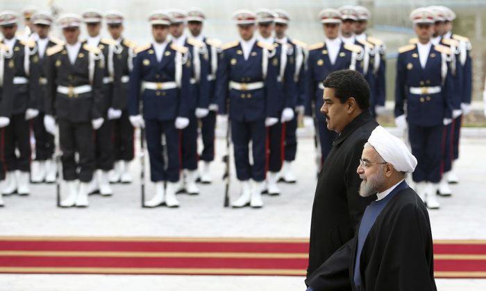 Venezuelan President Nicolas Maduro (L) is welcomed by his Iranian counterpart Hassan Rouhani during his official arrival ceremony at the Saadabad Palace in Tehran, Iran, on Saturday, Jan. 10, 2015.  (AP Photo/Iranian Presidency Office, Mohammad Berno)