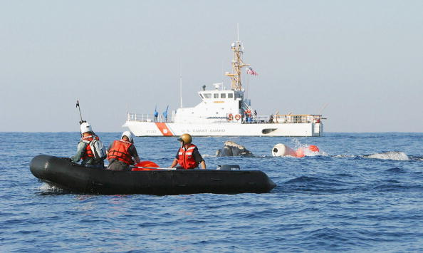 In this handout from the U.S. Coast Guard, Coast Guard Cutter Kingfisher provides assistance to NOAA Fisheries and Florida Fish and Wildlife Conservation Commission members in the attempts to free an entangled Northern Right Whale 60 miles east of Jacksonville, Florida, on March 23, 2004, at sea.  (Photo by the U.S. Coast Guard via Getty Images)