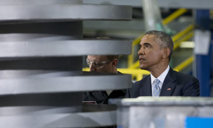 President Barack Obama tours Techmer PM, a plastic fabrication company, Friday, Jan. 9, 2015, in Clinton, Tenn. Obama will spend most of the week ahead focusing on identity theft, electronic privacy and other cyberspace issues. The events are part of Obama's strategy of providing sneak peeks of the proposals he'll outline in his upcoming State of the Union address. (AP Photo/Carolyn Kaster)