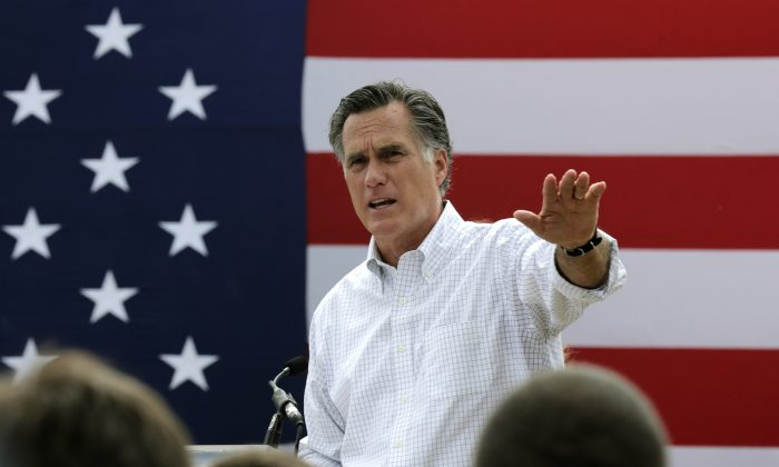 Mitt Romney, the former Republican presidential nominee, addresses a crowd of supporters while introducing New Hampshire Senate candidate Scott Brown at a farm in Stratham, N.H., on July 2, 2014.(AP Photo/Charles Krupa)