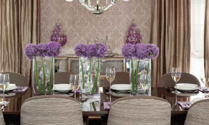 The dining room is neutral, with pops of colour brought in with floral arrangements and dishes. (Donna Griffith)