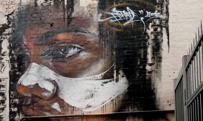 Street art depicting an Aborigine by an unidentified artist in Adelaide, Australia, seen April 26, 2014. (Shutterstock*)