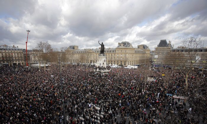 A crowd gather in Republique square before the demonstration, in Paris, France, Sunday, Jan. 11, 2015. A rally of defiance and sorrow, protected by an unparalleled level of security, on Sunday will honor the 17 victims of three days of bloodshed in Paris that left France on alert for more violence. (AP Photo/Laurent Cipriani)