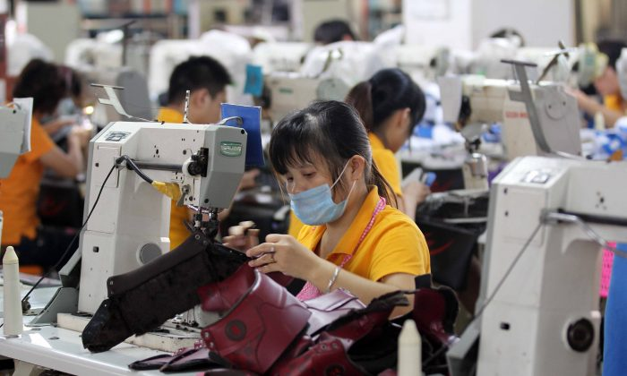 Laborers work in a shoe factory in Jinjiang, south China's Fujian province on Sept. 17, 2013.  (STR/AFP/Getty Images)