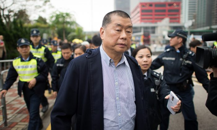 Hong Kong media tycoon and pro-democracy supporter Jimmy Lai leaves a police station in Hong Kong on Dec. 3, 2014. (Johannes Eisele/AFP/Getty Images)