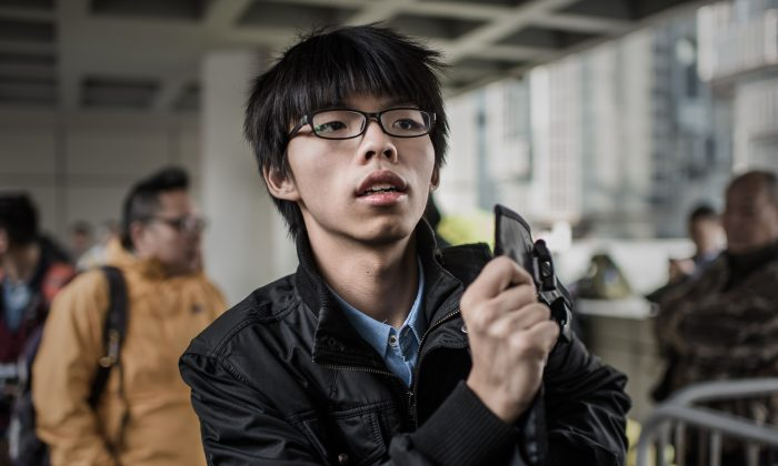 Hong Kong student activist Joshua Wong is pictured outside the High Court in Hong Kong on Jan. 8, 2015. (Philippe Lopez/AFP/Getty Images)