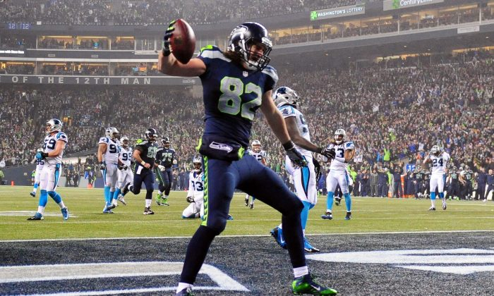 Luke Willson #82 of the Seattle Seahawks celebrates after scoring a 25 yard touchdown in the fourth quarter against the Carolina Panthers during the 2015 NFC Divisional Playoff game at CenturyLink Field on January 10, 2015 in Seattle, Washington. (Photo by Steve Dykes/Getty Images)