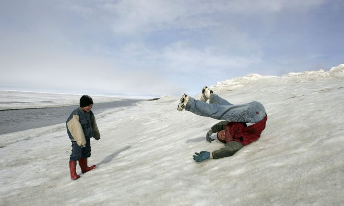 Inupiat Eskimo children play along the banks of the frozen Arctic Ocean in Browerville, Alaska, in this file photo. (Justin Sullivan/Getty Images)
