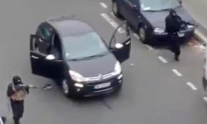 Masked gunman fire their weapons outside the French satirical newspaper Charlie Hebdo's office in Paris on Jan. 7, 2015. Though it is impossible to gauge in any tangible way the effect the deadly attack on a Paris newspaper will have on recruitment by extremist groups - and there is no evidence so far that it is mobilizing large numbers of would-be jihadis - experts believe the perceived professionalism of the brothers' assault and their subsequent showdown with police could rally more supporters to militant ranks. (AP Photo)