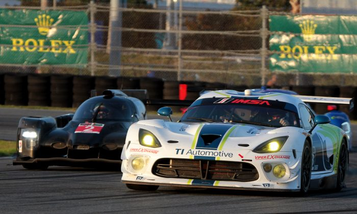 The #93 Riley Motorsports Viper leads the #2 Extreme Speed Motorsports HPD ARX-04a around the East Horseshoe during the IMSA TUSC Roar Before the 24, Jan. 10, 2015. These cars, and more than 50 others like them, will be racing in the Rolex 24 Jan. 24–25. (Chris Jasurek/Epoch Timers)