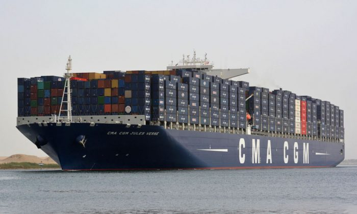A picture taken on May 30, 2013, from the Egyptian port of Ismailia, 120 kilometers northeast of Cairo, shows the new largest container ship in the world, French flag Jules Verne, crossing the Suez Canal. (STR/AFP/Getty Images)