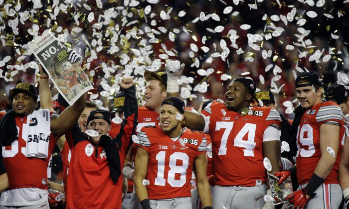 Ohio State players celebrate after the NCAA college football playoff championship game against Oregon Monday, Jan. 12, 2015, in Arlington, Texas. Ohio State won 42-20. (AP Photo/Eric Gay)