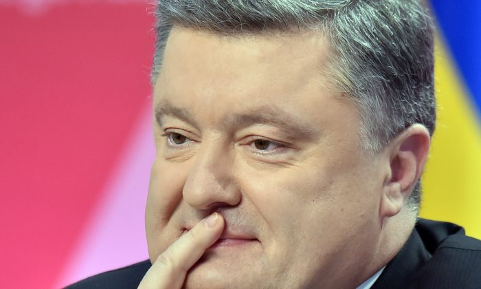 Ukrainian President Petro Poroshenko thinks as he listens to a question during the annual press-conference in Kiev on Dec. 29, 2014. (Sergei Supinsky/AFP/Getty Images)