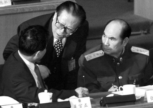 Chinese Communist Party head Jiang Zemin (C) chats with Shandong Communist Party Secretary Wu Guanzheng (L) and Vice Chairman of the Central Military Commission (CMC) General Zhang Wannian in Beijing, March 6, 2000. At a Party meeting in 2002, Zhang would propose that Jiang be retained as head of the CMC for two years after his scheduled retirement. (Goh Chai Hin/AFP/Getty Images)
