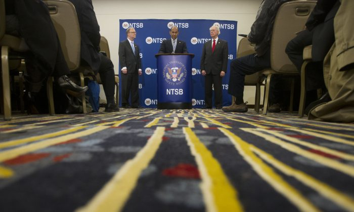 National Transportation Safety Board (NTSB) Acting Chairman Christopher A. Hart (C), with NTSB members Robert L. Sumwalt (L) and Earl F. Weener (R), answers questions regarding yesterday's subway incident during a NTSB news conference in Washington, Tuesday, Jan. 13, 2015. The transit network in the nation's capital, which is being investigated the incident, remains hobbled after an electrical malfunction that filled a busy subway station with smoke, killing one woman and sending dozens of people to hospitals. (AP Photo/Pablo Martinez Monsivais)