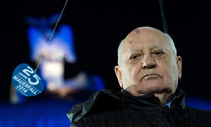 Former leader of the Soviet Union Mikhail Gorbachev takes part in the celebration on the occasion of the 25th anniversary of the fall of the Berlin Wall in front of the Brandenburg Gate in Berlin, Germany, Nov. 9, 2014. (AP Photo/dpa, Bernd von Jutrczenka)