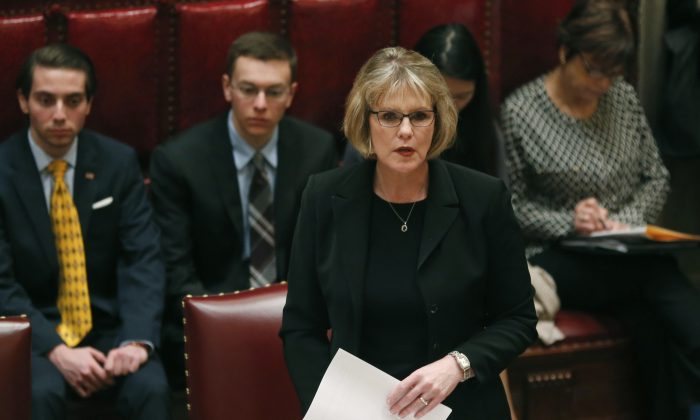 Sen. Catharine Young, R-Olean in the Senate Chamber at the state Capitol in Albany, N.Y., on Monday, Jan. 12, 2015. The Republican-controlled Senate has approved eight bills intended to ensure women's rights in the workplace and housing. (AP Photo/Mike Groll)