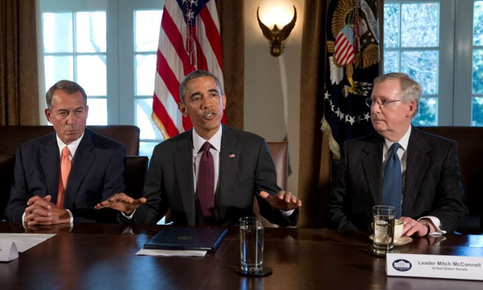 President Barack Obama (C), joined by House Speaker John Boehner of Ohio (L), and Senate Majority Leader Mitch McConnell of Ky. (R), speaks to media before his meeting with bipartisan, bicameral leadership of Congress to discuss a wide range of issues, Tuesday, Jan. 13, 2015, in the Cabinet Room of the White House in Washington. (AP Photo/Carolyn Kaster)