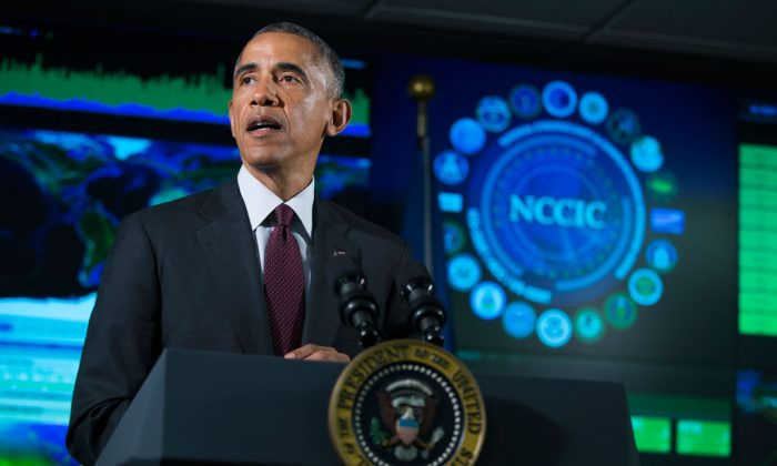 President Barack Obama speaks at the National Cybersecurity and Communications Integration Center in Arlington, Va., on Tuesday, Jan. 13, 2015. Obama renewed his call for Congress to pass cybersecurity legislation, including a proposal that encourages companies to share threat information with the government and protects them from potential lawsuits if they do. (AP Photo/Evan Vucci)