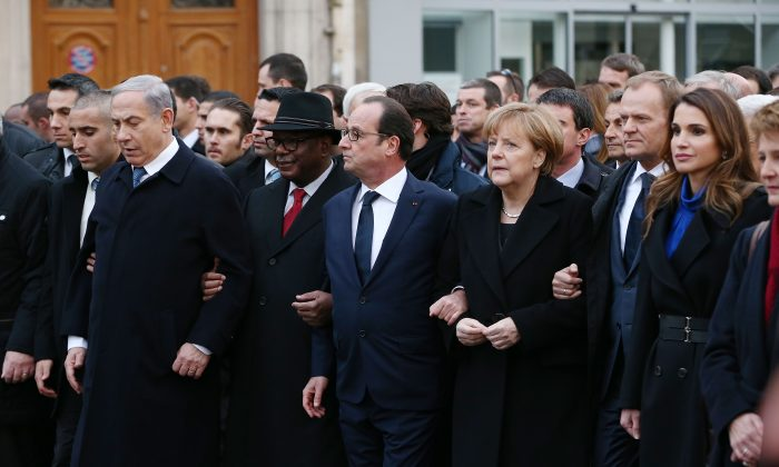 (L-R) Israeli Prime Minister, Benjamin Netanyahu; French President, Francois Hollande; and German Chancellor, Angela Merkel link arms during a unity march in Paris, France on Jan. 11, 2015, following terrorist attacks in the French city last week. (Dan Kitwood/Getty Images)