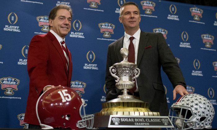 Alabama coach Nick Saban (L) and Ohio State coach Urban Meyer have seven national titles between them. (AP Photo/Brynn Anderson)